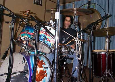 Gregg Gerson on drums